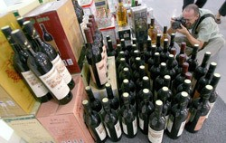 Counterfeit wine bottles on display in Beijing, 12 June 2007.